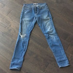 J Brand distressed jeans in medium/light wash